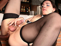Stocking clad tranny slut has a load dumped deep in her ass