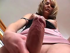 Yummy shemale plays with huge cock